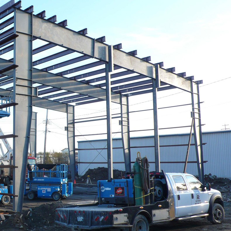 Pre-Fabricated steel building being assembled