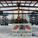 Paul Bros sign in front of partially built steel building
